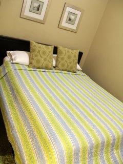 2nd bedroom with queen bed and in suite bathroom
