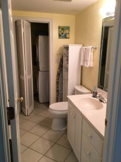 Master bath and laundry area with front-load washwer and dryer
