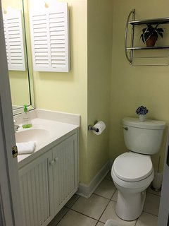 Guest bath in hallway just across from second bedroom