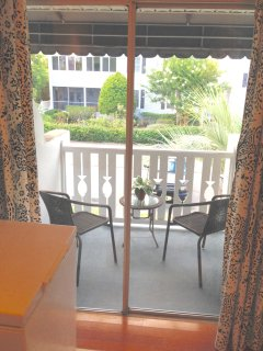 Covered deck upstairs - great for morning coffee or rain showers