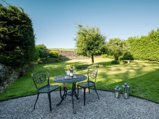 Large walled garden with views over the fields  and private seating area