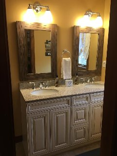 Newly renovated second level bathroom with double sink