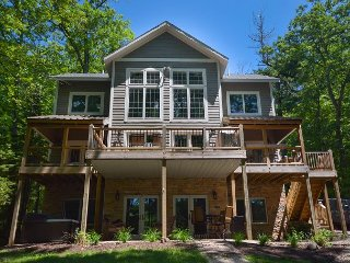 Immaculate 5 Bedroom lakefront home with luxurious furnishings throughout!