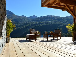 Chalet individuel , charme et prestige , terrasse de 110 m2 face aux pistes