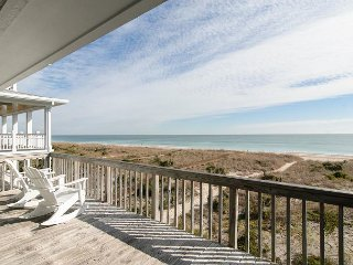 Top floor oceanfront condo with community dock and boat slip