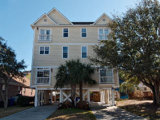 Enjoy the beach by day and the pool by night in this premier townhouse