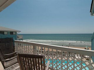 Overlook both the pool and the sandy beaches from this oceanfront condo