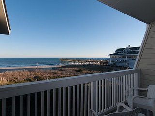 Take in breathtaking views at this oceanfront town home with boat slip!