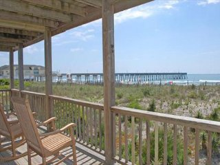 This oceanfront duplex is only one block from Johnnie Mercer's Pier
