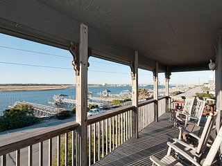 Upper level soundfront duplex with complimentary Banks Channel sunsets