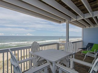Escape to this updated oceanfront condo with long coastline views