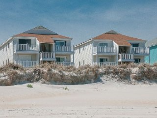 Top floor oceanfront condo with large deck and sweeping coast views