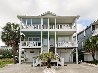 Treat your family to this magnificent home across the street from the beach.
