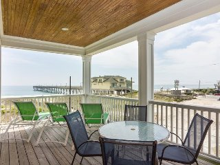 Catch the Atlantic sunrise from this oceanfront duplex next to the pier
