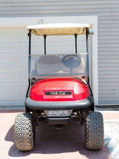 Red Lifted Golf Cart