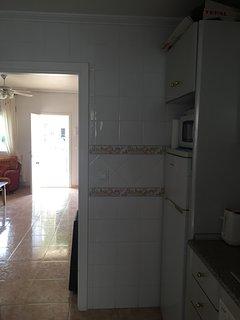Kitchen through living room
