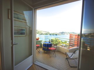 Panoramic view over the sea in quiet but central village apartment....