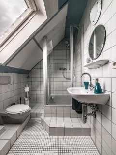 Bathroom with shower and bathtub. towels are provided
