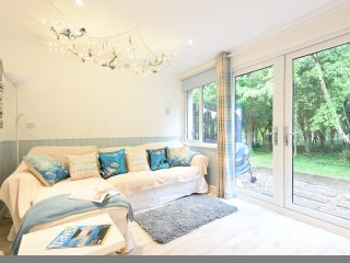 St Ives - Beach hut themed, self catering bungalow in 100 acre of woodland .