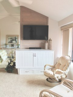 Master bedroom media wall with 50' TV and stereo