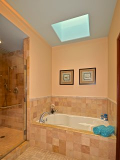 Master bathroom with oversized bath tub and roomy shower.