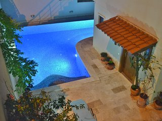 The pool starts at the front door, and ends at the back