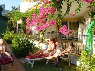 Relax in lush garden surroundings