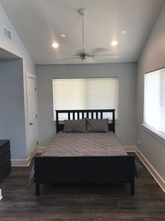 Queen bed at front of house/ Semi private with drape for closing off