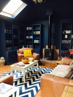 Sumptuous library lounge with log burning stove