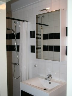Small bathroom with shower, sink and toilet