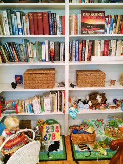 Library, children's toys, rocking chair in queen bedrom. Dedicated closet across hallway.