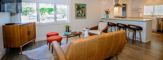 Open living concept with authentic hardwood flooring