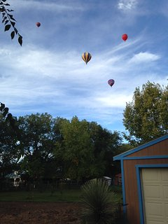 Balloons fly right over the casita.