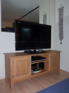 Entertainment center has new 40' flat screen TV, DVD player, games and books.