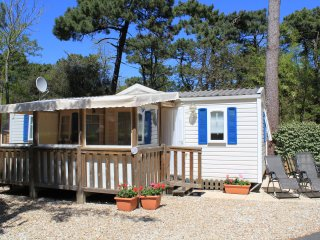 Our luxury 3-bed mobile-home with shed to the left patio area to the right car-parking to the front.