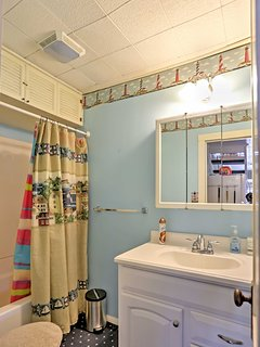Rinse off with a hot shower in this full bathroom.