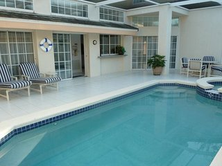 3241SW. Lovely 3 Bedroom 3 Bath Villa with Private Courtyard Style Pool Area