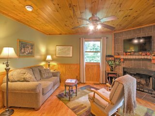 This cozy cabin offers rustic wood paneling throughout, creating a warm and welcoming environment.