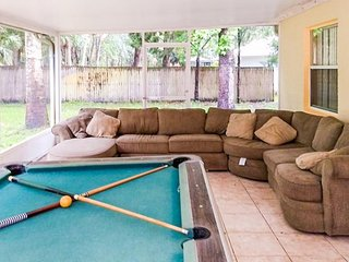 Spacious, family-friendly home with a private hot tub, pool table, grassy yard