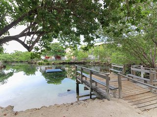 Waterfront condo w/ balcony & views, shared pool & dock