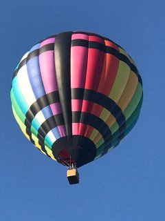 In the early AM hours, if you  look to the western skies, you will see hot air balloons floating by.