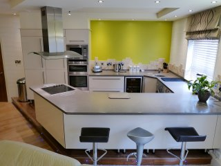 Luxury kitchen with drinks cooler and large breakfast bar.