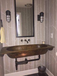 The antique wooden sink in the upper floor bathroom.