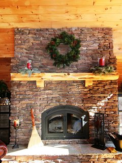 Stay warm and cozy by the natural stone fireplace at Beech View Lodge. #fireplace