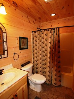 The second bath is located just beside the guest room, and a laundry area is down the hall, perfect for longer stays.