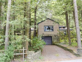 Split-lakefront home w/ private hot tub, dock, firepit, porch & views - Dogs OK!