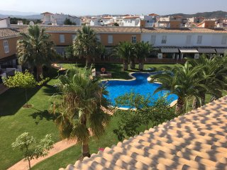 Beautiful 2 bed Town House with pool and gardens in quiet area close to beach