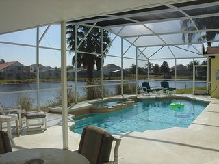 Gorgeous Lakefront 4 bed 2 full and 2 half baths.South facing pool and whirlpool. Game room.