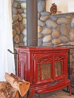 The fireplace/wood burning stove provides ample heat throughout the winter months