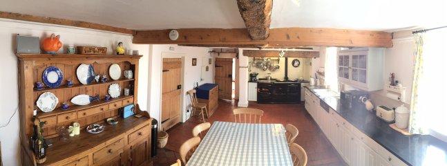 Home Farmhouse Kitchen with 4 oven Aga. seating 14